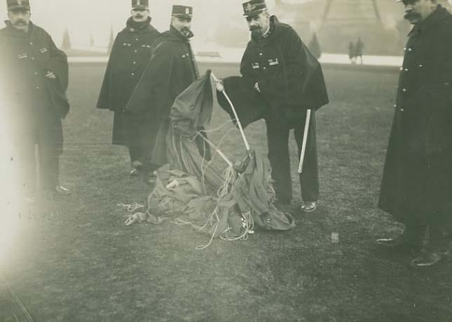Police recover the damaged parachute.