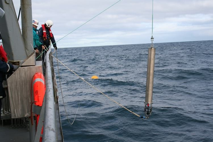 A hydrophone being lowered into the sea.